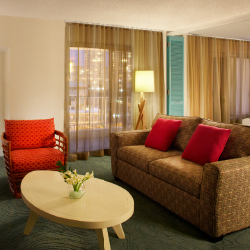 Guestrooms at Aqua Oasis, a Joy Hotel, are accented with bold colors and patterns. // © 2014 Aqua Oasis, a Joy Hotel