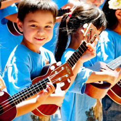 Oahu's annual Ukulele Festival features an orchestra of children on ukuleles. // © 2014 Tina Mahina