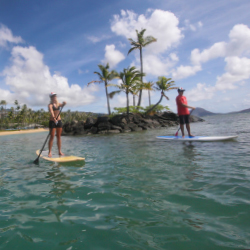 Clients can try stand-up paddleboarding at Kahala Hotel and Resort. // © 2014 Hans Hedemann