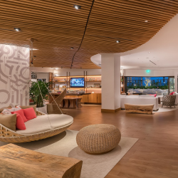 <p>The lobby is located on the eighth floor. // © 2017 Hyatt Centric Waikiki Beach</p><p>Feature image (above): Near the wading pool is a fire pit and...