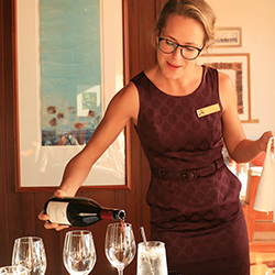 <p>Vanessa Lampson leads wine tastings at Montage Kapalua Bay. // © 2015 Montage Kapalua Bay</p><p>Feature image (above): Cane & Canoe restaurant...