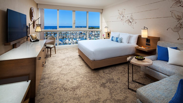 A sense of place informs Prince Waikiki's guestrooms, with floor-to-ceiling windows and naio blossom prints on the walls.