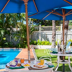 <p>At The Plantation Inn, breakfast is served in a peaceful, poolside courtyard. // © 2017 The Plantation Inn</p><p>Feature image (above): Guest rooms...