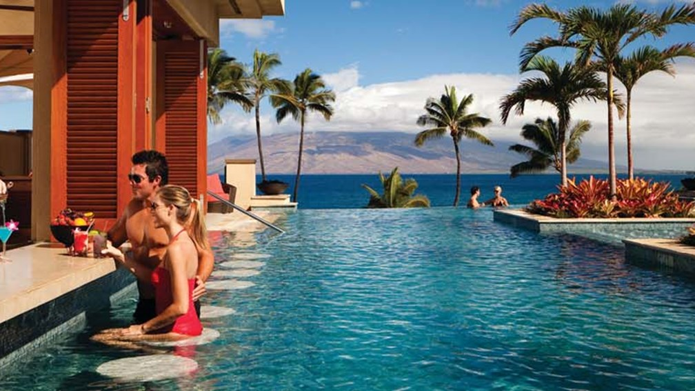 With cabanas, a swim-up bar and an underwater music system, the Serenity pool is a favorite destination at the Four Seasons Resort Maui. // © 2014 Four Seasons Resort Maui F