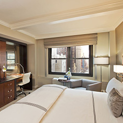 <p>Guestrooms at the Quin feature deluxe amenities such as Venetian bed linens and an espresso machine. // © 2014 The Quin </p><p>Feature image...