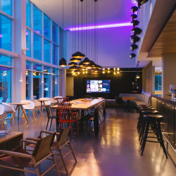 Moxy guests can socialize in living room-like lobbies. // © 2015 Marriott