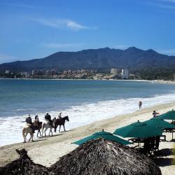 Visitors can go horseback riding on the beach in Bucerias, Riviera Nayarit. // © 2014 Irene Middleman Thomas