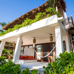 <p>Accommodations at The Beach Tulum are eco-friendly and comfortable. // © 2015 The Beach Tulum</p><p>Feature image (above): Tulum is an ideal...