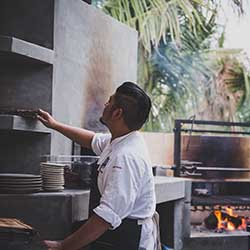 <p>Executive chefs Kevin Luzande (above) and Oscar Torres have created original dishes such as wood-fire carrots, tenderfoot goat belly and kabocha...
