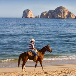 Los Cabos Lover's Beach is known for being one of the town's more secluded beach spots.  // © 2013 Los Cabos Convention & Visitors Bureau