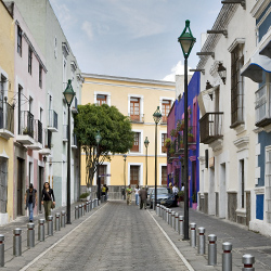 <p>Colorful buildings in historic downtown Puebla // © 2015 Mexico Tourism Board</p><p>Feature image (above): Cafes and historic structures are among...