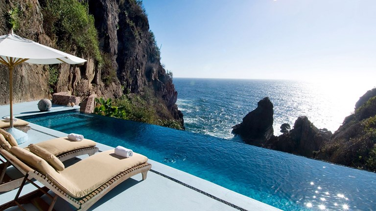"""Careyes' signature """"castles"""" are perched over the coastline."""