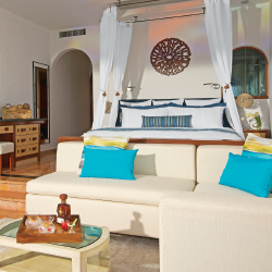 <p>A junior oceanfront suite at AMResorts' Zoetry Villa Rolandi Isla Mujeres Cancun // © 2015 AM Resorts</p><p>Feature image (above): The beach at...