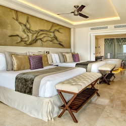<p>A Chairman Suite at Royalton Riviera Cancun // © 2016 Royalton Riviera Cancun Resort & Spa</p><p>Feature image (above): The property's...