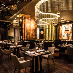<p>Clients can savor French dishes at Piaf. // © 2017 Grand Velas Los Cabos</p><p>Feature image (above): The resort's curved walls are meant to...