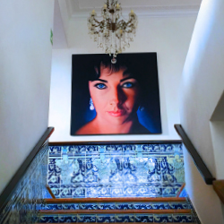 <p>A striking painting of Elizabeth Taylor greets guests in the stairwell. // © 2017 Lina Zeldovich</p><p>Feature image (above): A bridge connects...