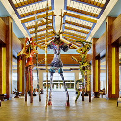Barcelo Maya Beach guests are greeted by larger-than-life mosaic sculptures in the lobby. © // Barceló Hotels & Resorts