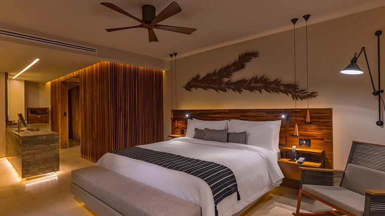 Guestrooms feature wood decor and warm tones.