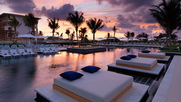 Enjoy spectacular sunsets by the pool.