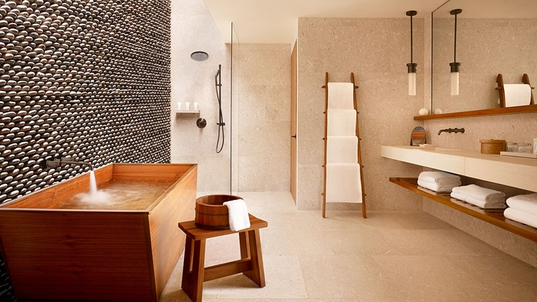 Bathrooms at the 200-room property include features such as teak onsen (Japanese hot spring) soaking tubs.