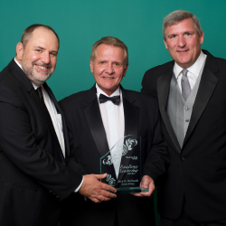 <p>Pleasant Holiday's Jack E. Richards (center) with TravelAge West's Kenneth Shapiro (left) and Robert Sullivan at the 2015 WAVE Awards. // © 2016...