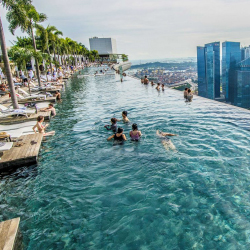 <p>Marina Bay Sands Hotel's pool is 650 feet off the ground. // © 2016 Marina Bay Sands</p><p>Feature image (above): Get up-close to elephants at Four...