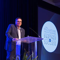 <p> Alex Sharpe, president and CEO of Signature Travel Network, addressed members during a general session. // © 2017 Signature Travel...