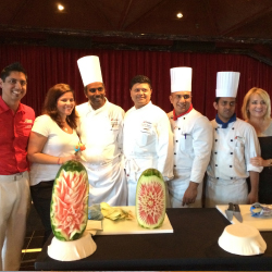 Drew Santiago (left), Jennifer Buenrostro (second from left) and Vicky Tomasino (far right) made chocolate cake with Carnival Imagination's kitchen...