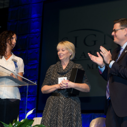 Carol Lekki (center) receives the first annual Michelle Morgan Leadership Award at Signature's sales meeting and trade show. // © 2014 Signature...