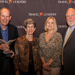 Award winners Arvid and Pat Olson and Denise Palumbo with Roger Block of Travel Leaders Franchise Group // © 2014 Travel Leaders