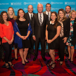 "ASTA executives pose with Captain ""Sully"" Sullenberger (center), who gave the conference's keynote address. // © 2016 American Society of Travel..."