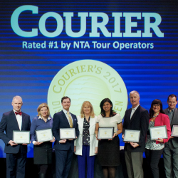 Winners of the Distinguished Dozen during NTA's Travel Exchange with Bob Rouse, editor of Courier (second from right), and Kami Risk, president of NTA...