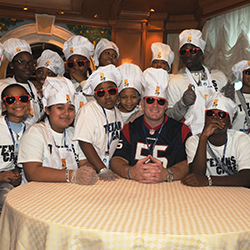 Houston Texans player Chris Myers with a team of Boys & Girls Club kids for Jr. Training Camp@Sea onboard Emerald Princess. // © 2015 Princess...