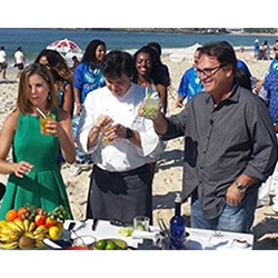 "<p>Vinicius Lummertz (right) toasts ""Today"" host Natalie Morales (left) and a member of Portela Samba School on air. // © 2015 Brazilian Tourism..."