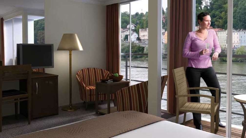 An AmaBella balcony suite provides a charming view of local scenery. // © 2013 Ama Waterways F