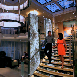 <p>From left: A Viking Freya suite; the vessel's modern atrium // © 2015 Viking River Cruises</p><p>Feature image (above): Guests on Viking's Danube...