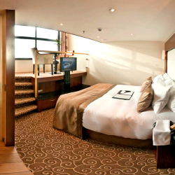 <p>Tauck created a new stateroom category: the loft cabin. // © 2015 Tauck</p><p>Feature image (above): Some Tauck river cruises begin or end in...