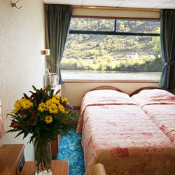 <p>MS France suites offer private baths and satellite television. // © 2014 CroisiEurope</p><p>Feature image (above): Amenities onboard CrosiEurope's...