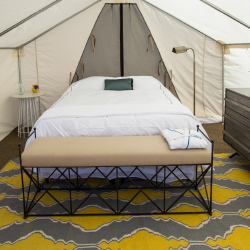 <p>Tents offer beds with memory-foam mattresses and other modern perks. // © 2015 TerraVelo Tours</p><p>Feature image (above): Clients can cycle in...