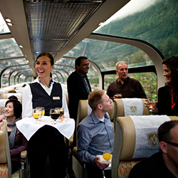 <p>Passengers enjoy complimentary alcoholic and nonalcoholic beverages throughout the train journey. // © 2017 Rocky Mountaineer</p><p>See views of...