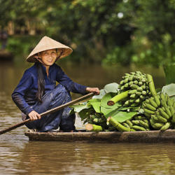 Vietnamese woman on boat. // © 2013 Thinkstock