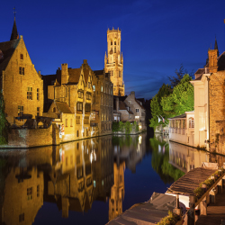 Sightseeing in Belgium includes a canal-side dinner in Bruges. // © 2014Allard1