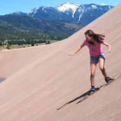 <p>Adventure seekers can try sandboarding in the park. // © 2014 Great Sand Dunes National Park & Preserve</p><p>Feature image (above): Four...