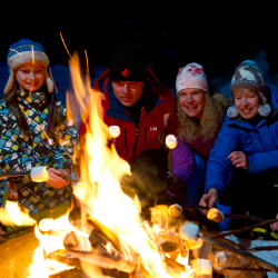 <p>Among the resort's family-friendly activities is a snowshoe hike to a campfire for s'mores. // © 2015 Sun Peaks/Adam Stein</p><p>Feature image...