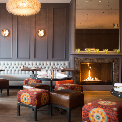 <p>The Kitchen's upstairs cocktail lounge // © 2017 Kitchen Next Door</p><p>Feature image (above): View the Flatirons rock formations from Pearl...