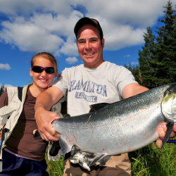 <p>A father and daughter with a silver salmon caught on her first Alaska fishing trip. // © 2017 Christopher Batin</p><p>Feature image (above): Silver...