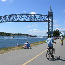 <p>Cyclists often ride their bikes alongside the Cape Cod Canal, enjoying the beautiful view. // © 2014 Kevin Burke</p><p>Feature image (above): Tall...