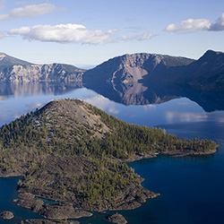 <p>Visitors to Crater Lake National Park can take a boat tour or shuttle to Wizard Island and spend the day hiking and exploring. // © 2016...