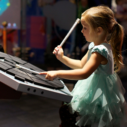 At The Museum of Making Music's interactive studio, guests can play a variety of instruments, including the electric drums. // © 2013 The Museum of...