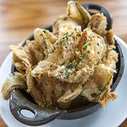 <p>The Row Kitchen & Pub, a restaurant in Nashville, features Southern cuisine such as fried pickles. // © 2015 Mark Edward Harris</p><p>Feature...